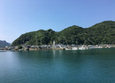 sakitsu-village-viewed-from-opposite-side-of-the-bay-showing-relationship-of-church-houses-y-topography-and-water